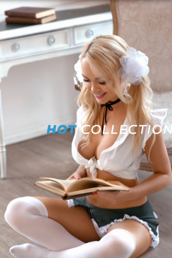 Schoolgirl London escort girl Chloe reading a very interesting book